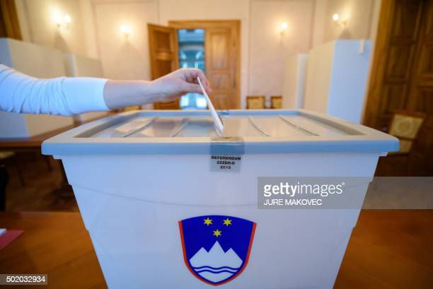 A Slovenian citizen casts a ballot at a polling station in Bled Slovenia on December 20 in a referendum on whether to allow the largelyCatholic EU...