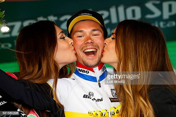 Slovenian cyclist Primoz Roglic of Lotto NL Jumbo team celebrates on the podium after winning the 9th individual time trial stage of 99th Giro...