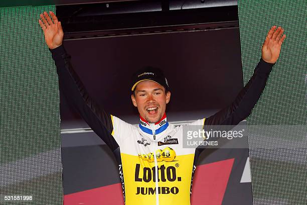 Slovenian cyclist Primoz Roglic of LottoNL Jumbo team celebrates on the podium after winning the 9th individual time trial stage of 99th Giro...