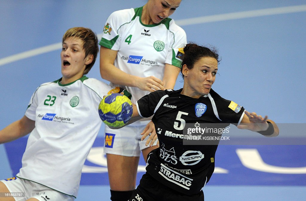 Slovenian Daniela Piedade (R) of RK Krim Mercator scores a goal against Hungarian Adrienn Szarka (C) and Zsuzsanna Tomori (L) of FTC Rail Cargo Hungaria in the local sports hall of Dabas on February 17, 2013 during their EHF Women's Champions League handball match.