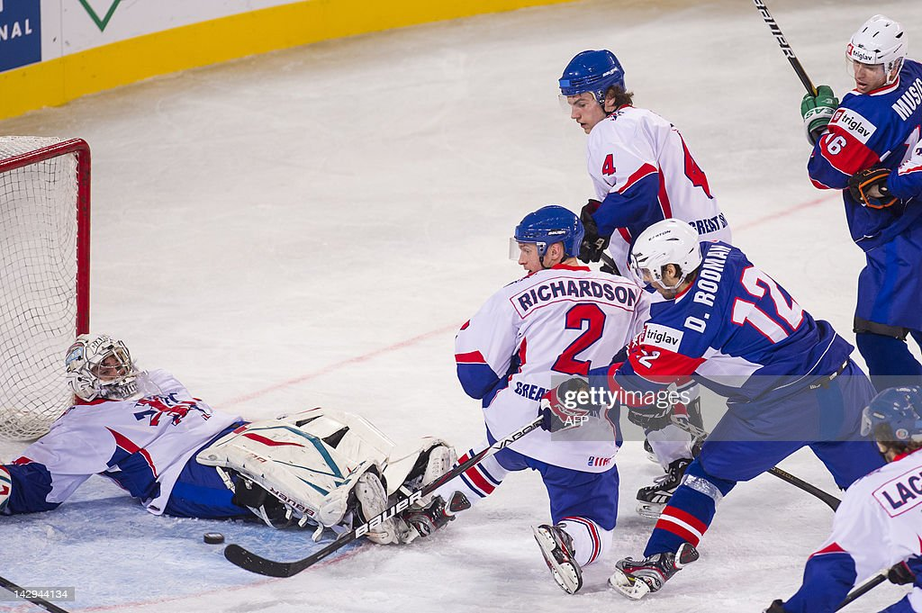 Slovenian Denis Rodman (#12) scores second goal for Slovenia during the 2012 IIHF Ice Hockey World Championship Division I Group A match between Britain and Slovenia at Arena Stozice in Ljubljana, on April 15, 2012.