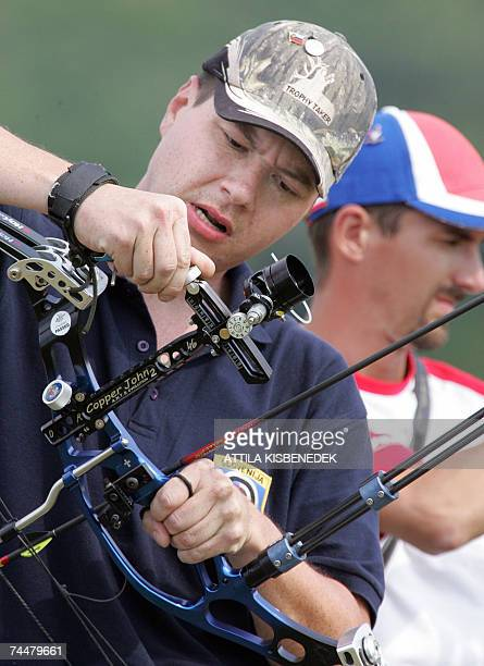 Slovenian gold medalist of individual compound men category David Rebec prepares his equipment at the sport park of SopronAgfalva during his final of...