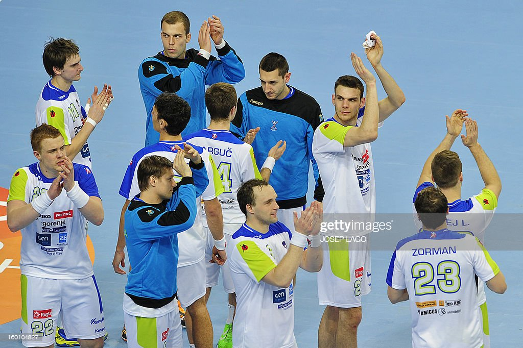 Slovenian handball team react at the end of the 23rd Men's Handball World Championships bronze medal match Slovenia vs Croatia at the Palau Sant Jordi in Barcelona on January 26, 2013. Croatia won 31-26.