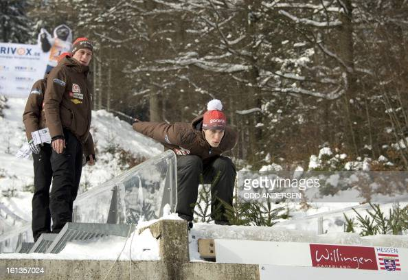 Slovenian jumper Jurij Tepes and team mates joke around on the jump as a wind delays postponing the FIS Ski Jumping World Cup individual large hill...