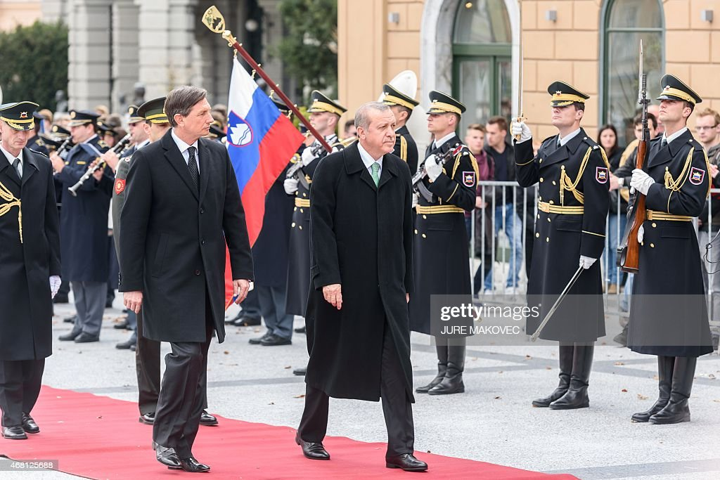 Slovenian President Boris Pahor (L) and his Turkish counterpart <a gi-track='captionPersonalityLinkClicked' href=/galleries/search?phrase=Recep+Tayyip+Erdogan&family=editorial&specificpeople=213890 ng-click='$event.stopPropagation()'>Recep Tayyip Erdogan</a> review an honour guard during their meeting in Ljubljana, Slovenia, on March 30, 2015.
