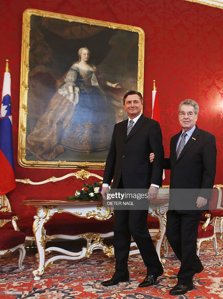 Slovenian President Borut Pahor (L) and Austrian President Heinz Fischer are pictured ahead a official meeting on February 6, 2013 in Vienna. AFP PHOTO / DIETER NAGL