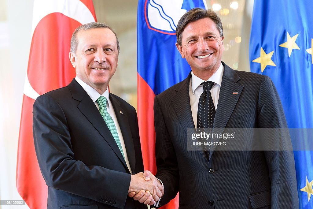Slovenian President <a gi-track='captionPersonalityLinkClicked' href=/galleries/search?phrase=Borut+Pahor&family=editorial&specificpeople=2476171 ng-click='$event.stopPropagation()'>Borut Pahor</a> (R) and his Turkish counterpart <a gi-track='captionPersonalityLinkClicked' href=/galleries/search?phrase=Recep+Tayyip+Erdogan&family=editorial&specificpeople=213890 ng-click='$event.stopPropagation()'>Recep Tayyip Erdogan</a> shake hands during their meeting in Ljubljana, Slovenia, on March 30, 2015. AFP PHOTO / JURE MAKOVEC