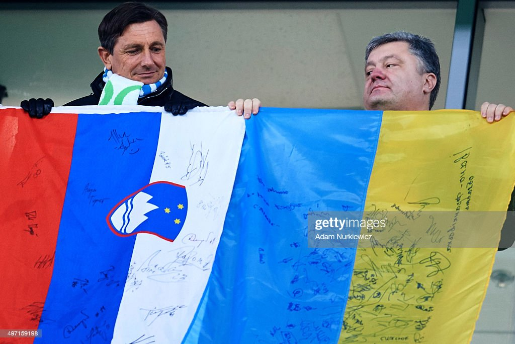 Slovenian President <a gi-track='captionPersonalityLinkClicked' href=/galleries/search?phrase=Borut+Pahor&family=editorial&specificpeople=2476171 ng-click='$event.stopPropagation()'>Borut Pahor</a> (L) and Ukrainian President <a gi-track='captionPersonalityLinkClicked' href=/galleries/search?phrase=Petro+Poroshenko&family=editorial&specificpeople=549382 ng-click='$event.stopPropagation()'>Petro Poroshenko</a> watch the action behind their national flags during the UEFA EURO 2016 Play-off for Final Tournament, First leg between Ukraine and Slovenia at Lviv Arena on November 14, 2015 in Lviv, Ukraine.