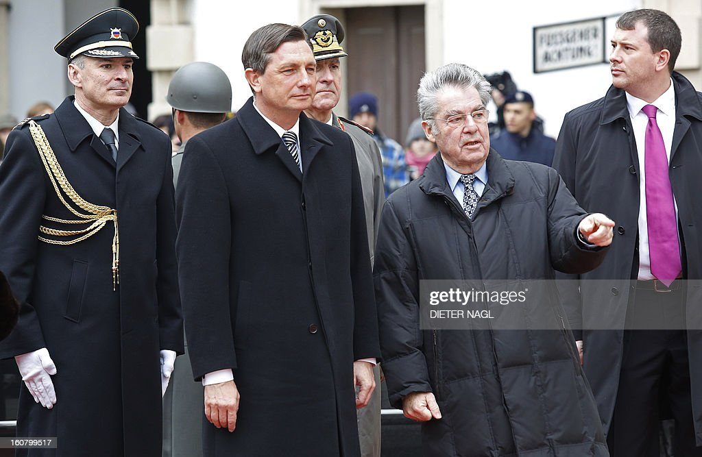 Slovenian President Borut Pahor (2nd L) is welcomed by Austrian President Heinz Fischer (3rd L) on February 6, 2013 in Vienna.