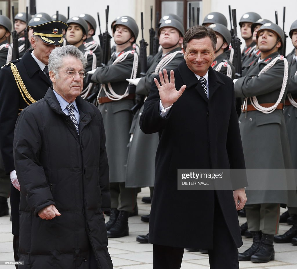 Slovenian President Borut Pahor (R) is welcomed by Austrian President Heinz Fischer (L) as they review a guard of honor on February 6, 2013 in Vienna.