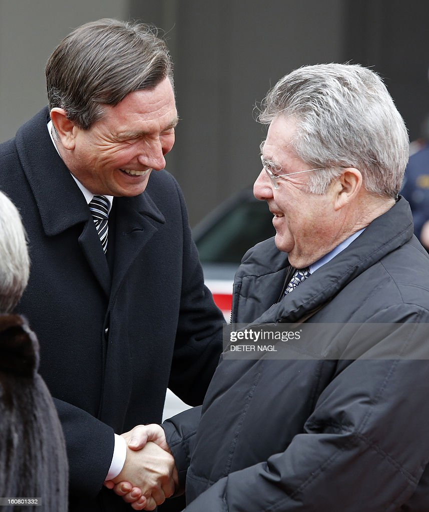 Slovenian President Borut Pahor (L) is welcomed by Austrian President Heinz Fischer (R) ahead a official meeting on February 6, 2013 in Vienna.