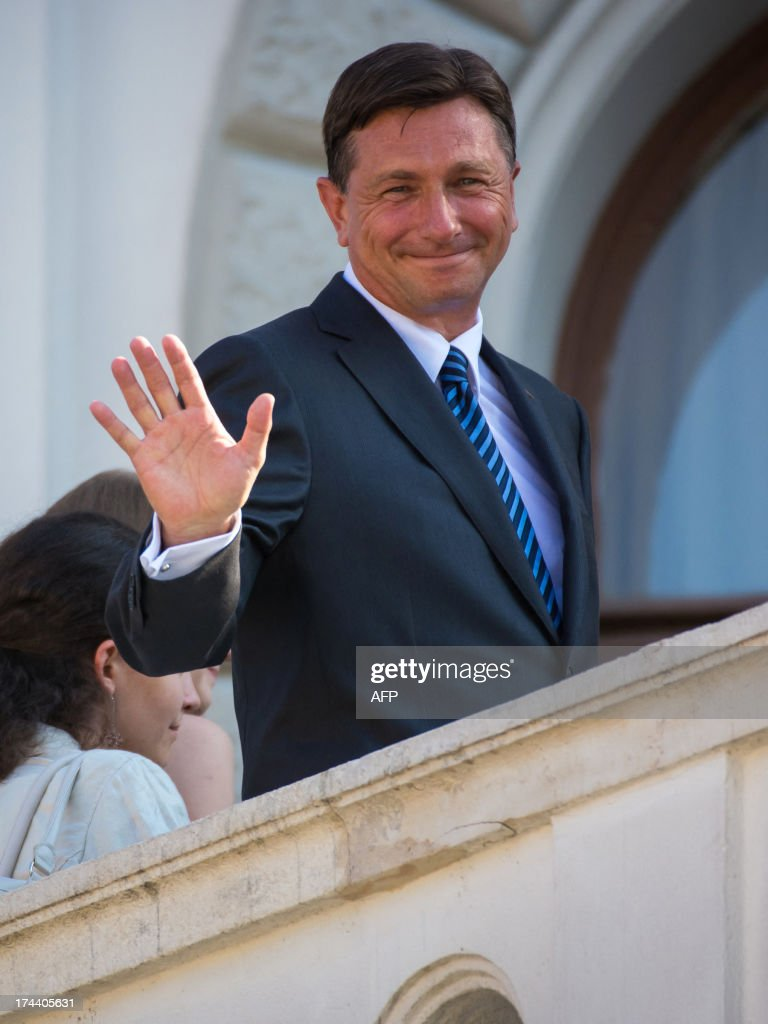 Slovenian President Borut Pahor waves to the crowd prior to a meeting with French President Francois Hollande on July 25, 2013, in Ljubljana. The presidents of eight western Balkans countries along with French president Francois Hollande met in Slovenia at an unprecedented summit aimed at promoting cooperation and further EU enlargement in the region. The summit was organized by the presidents of the only two former Yugoslav states that joined the EU, Slovenia's Borut Pahor and Croatia's Ivo Josipovic, and backed by the French president underlining the need for reforms for all Balkans states that would like to join the EU.