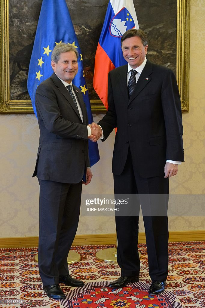 Slovenian President <a gi-track='captionPersonalityLinkClicked' href=/galleries/search?phrase=Borut+Pahor&family=editorial&specificpeople=2476171 ng-click='$event.stopPropagation()'>Borut Pahor</a> (R) welcomes European Commissioner for European Neighbourhood Policy and Enlargement Negotiations Johannes Hahn during a meeting on improved ecomomic and security cooperation in the Balkans involving six Balkan countries, France, Germany, Italy, Austria and the EU, in Brdo Pri Kranju, on April 23, 2015. AFP PHOTO / JURE MAKOVEC