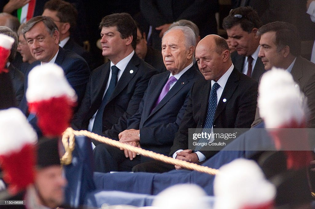 Slovenian President Danilo Turk (L), Israeli President Shimon Peres (3rd R) and Romanian President <a gi-track='captionPersonalityLinkClicked' href=/galleries/search?phrase=Traian+Basescu&family=editorial&specificpeople=542324 ng-click='$event.stopPropagation()'>Traian Basescu</a> (2nd R) attend the military parade to mark the founding of the Italian Republic and the 150th anniversary of Italian unification at Via dei Fori Imperiali on June 2, 2011 in Rome, Italy. The Italian Republic was founded in 1946 after the death of Benito Mussolini. This year 80 foreign delegations from all over the world attended the Italian military parade.