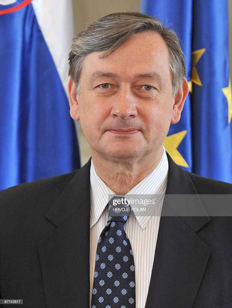 Slovenian President Danilo Turk poses in front of his national flag and the European Union one as he waits to meet with his newly elected Macedonian counterpart Gjorgje Ivanov in Ljubljana on May 18, 2009. Ivanov (not pictured) is on an official one-day visit to Slovenia.