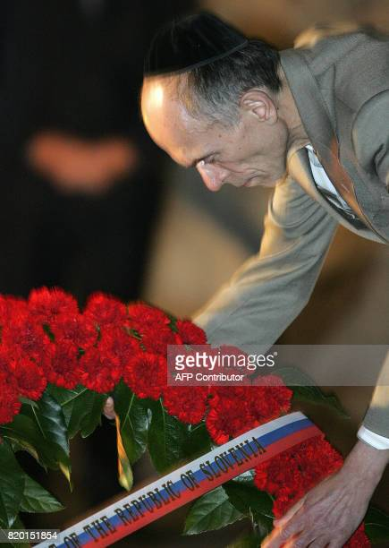 Slovenian President Dr Janez Drnovesk lays a wreath during his visit to the Holocaust Museum in Yad Vashem in Jerusalem 06 March 2006 Drnovsek is on...