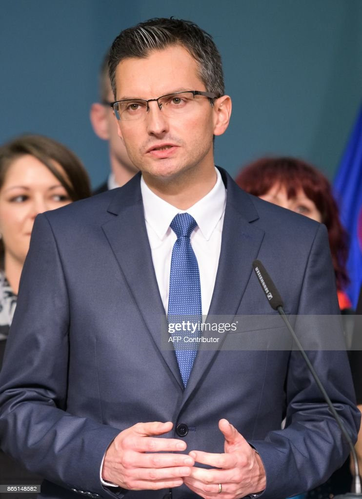 Slovenian presidential candidate and Mayor of Kamnik Marjan Sarec gestures as he addresses media representatives after the first official results of presidential elections were released in Ljubljana on October 22, 2017.