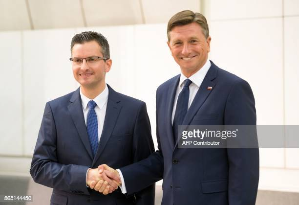 Slovenian presidential candidate and Mayor of Kamnik Marjan Sarec shakes hands with fellow candidate and current President of Slovenia Borut Pahor...
