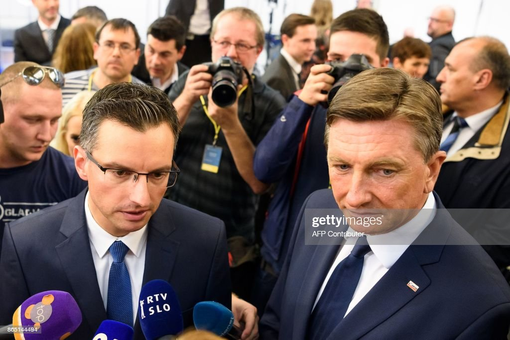 Slovenian presidential candidate and Mayor of Kamnik Marjan Sarec (L) stands with fellow candidate and current President of Slovenia Borut Pahor as they address media representatives after the first official results of presidential elections were released in Ljubljana on October 22, 2017.