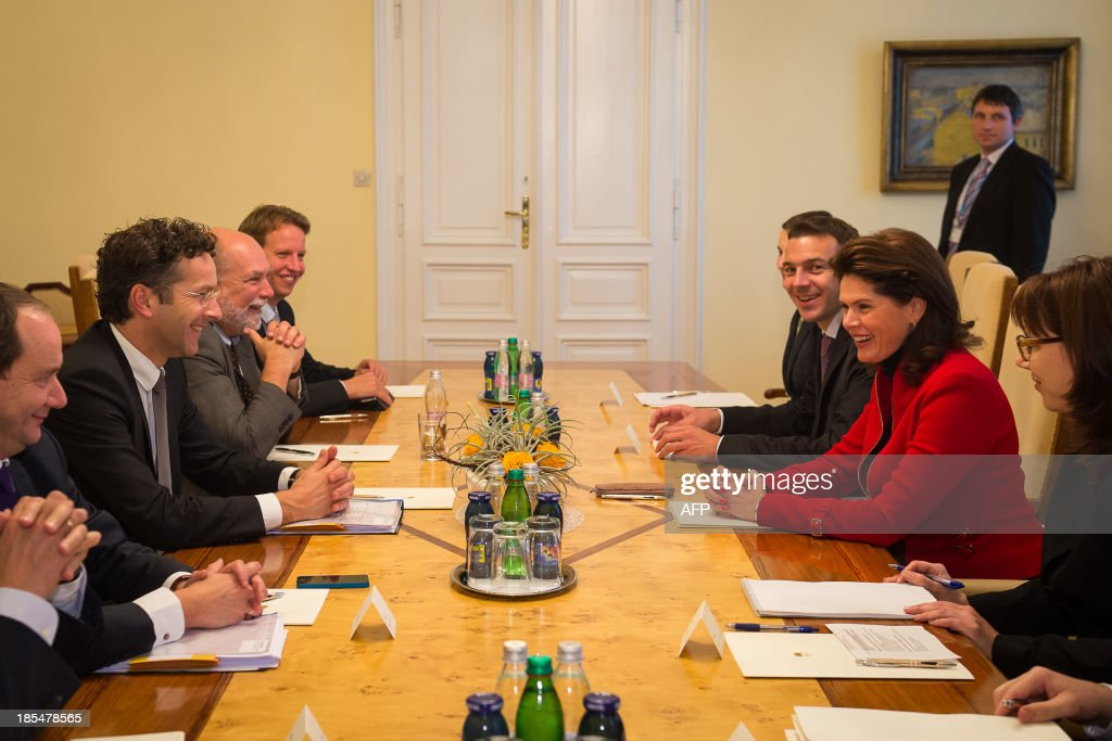 Slovenian Prime Minister Alenka Bratusek (2nd R), Slovenian Finance minister Uros Cufer (3rd R), and Dutch Finance Minister and Eurozone President Jeroen Dijsselbloem (2nd L) take part in a meeting in Ljubljana, on October 21, 2013. Whether Slovenia will need international help will depend on ongoing bank reviews which will still take time, Eurogroup chairman Jeroen Dijsselbloem said on October 21, urging patience amid fears of another bailout. 'A lot of work is to be done, but it is crucial that we do it right, and that the assessment of the banks is done at the highest quality standard,' Dijsselbloem told a joint news conference with Slovenian finance minister Uros Cufer.