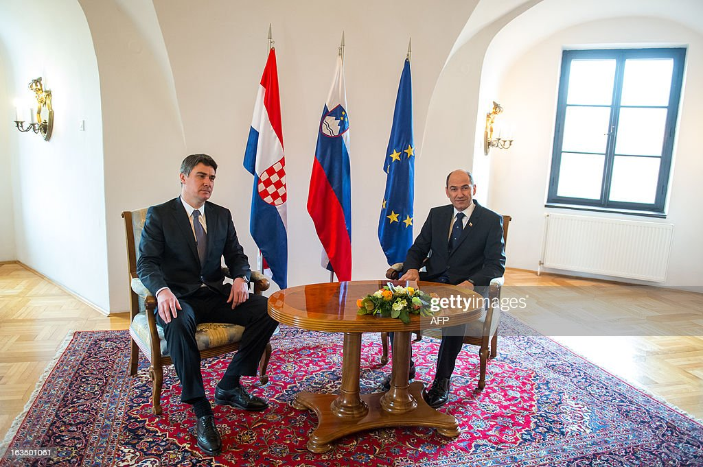 Slovenian Prime Minister Janez Jansa (R) and his Croatian counterpart Zoran Milanovic meet in Mokrice on March 11, 2013 in a bid to end a banking dispute which has threatened Croatia's entry into the EU this July.