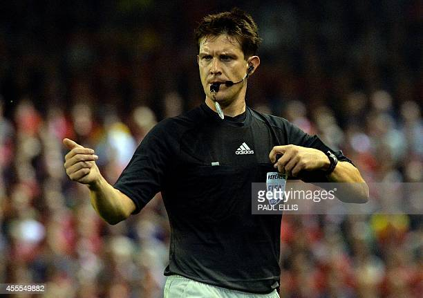 Slovenian referee Matej Jug gestures during the UEFA Champions League Group B match between Liverpool and Ludogorets Razgrad at the Anfield stadium...