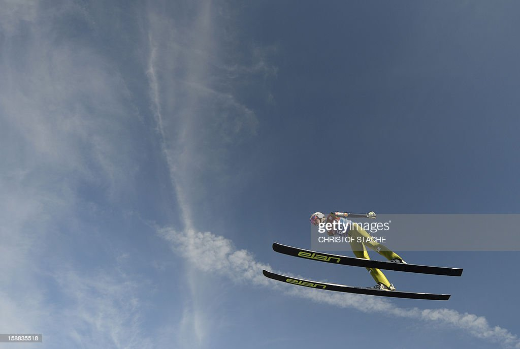 Slovenian ski jumper Jaka Hvala soars through the air during his trial jump at the 61th edition of the Four-Hills-Tournament (Vierschanzentournee) on December 31, 2012 in Garmisch-Partenkirchen, southern Germany. The second competition of the jumping event will take place in Garmisch-Partenkirchen, before the tournament continues in Innsbruck (Austria) and in Bischofshofen (Austria). AFP PHOTO/CHRISTOF STACHE