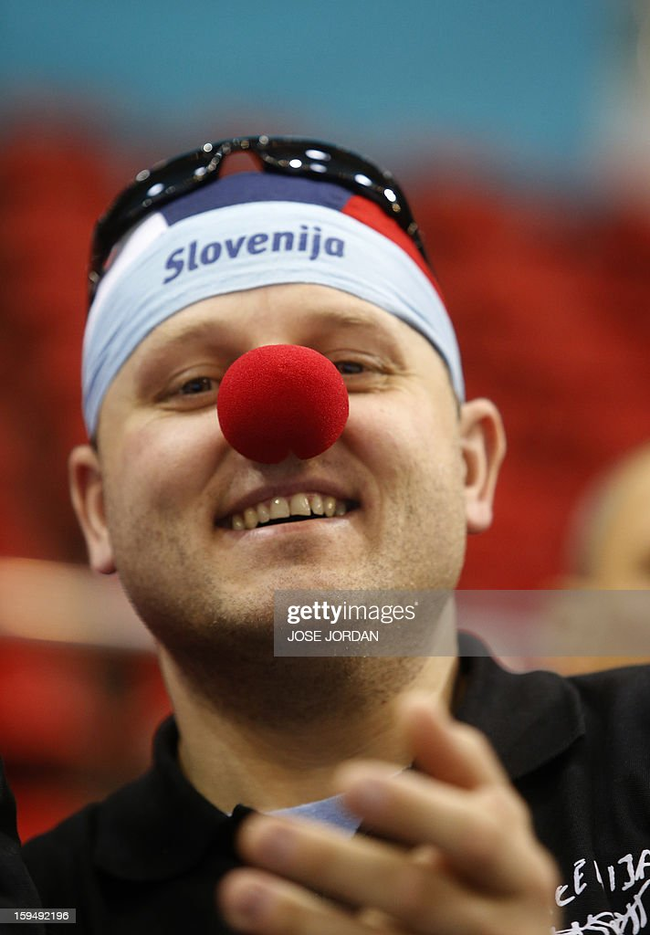 A Slovenian supporter, wearing a clown nose, reacts during the 23rd Men's Handball World Championships preliminary round Group C match South Korea vs Slovenia at the Pabellon Principe Felipe in Zaragoza on January 14, 2013.