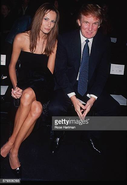 Slovenianborn American former model Melania Trump and her husband real estate developer Donald Trump attend a fashion week event in Bryant Park New...