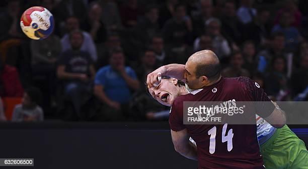 TOPSHOT Slovenia's back Jure Dolenec shoots on goal despite Qatar's pivot Bassel Alrayes during the 25th IHF Men's World Championship 2017 quarter...
