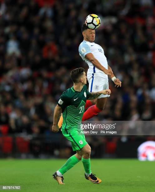 Slovenia's Benjamin Verbic and England's Alex OxladeChamberlain battle for the ball in the air during the 2018 FIFA World Cup Qualifying Group F...