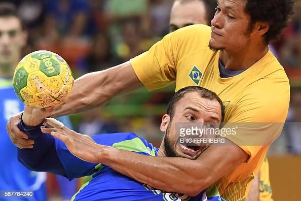 TOPSHOT Slovenia's centre back Uros Zorman vies with Brazil's left wing Thiagus dos Santos during the men's preliminaries Group A handball match...
