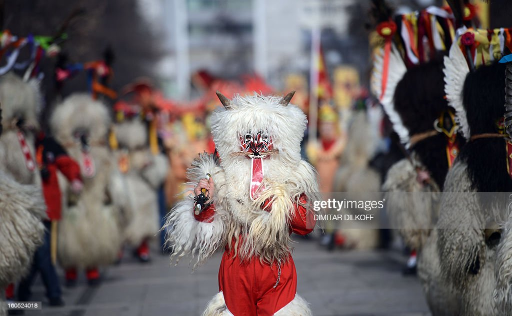 Slovenia's dancers attend the International Festival of the Masquerade Games in Pernik near the capital Sofia, on February 2, 2013. The three-day festival, which started on January 28, has participants sporting multi-colored masks, covered with beads, ribbons and woolen tassels whlie the main dancer, ladened with bells to drive away sickness and evil spirits, sways like a wheat spikelet heavy with grain. AFP PHOTO / DIMITAR DILKOFF