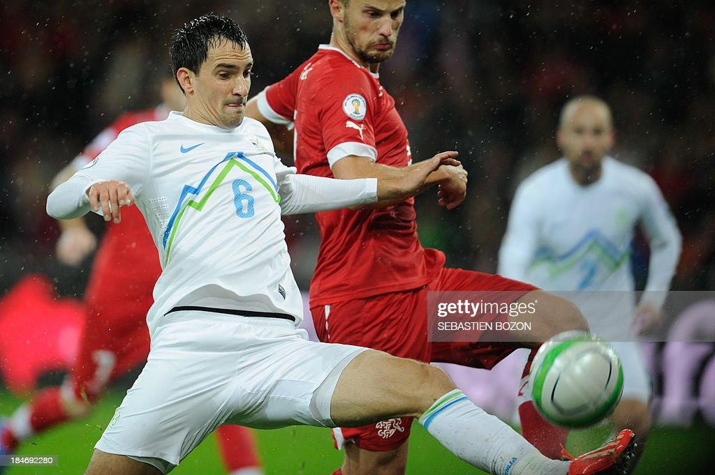 Slovenia's defender Branko Ilic (L) vies with Switzerland's midfielder Haris Seferovic (R) during the world cup 2014 qualifiying football match Switzerland vs Slovenia on October 15, 2013, at the Stade de Suisse, in Bern.
