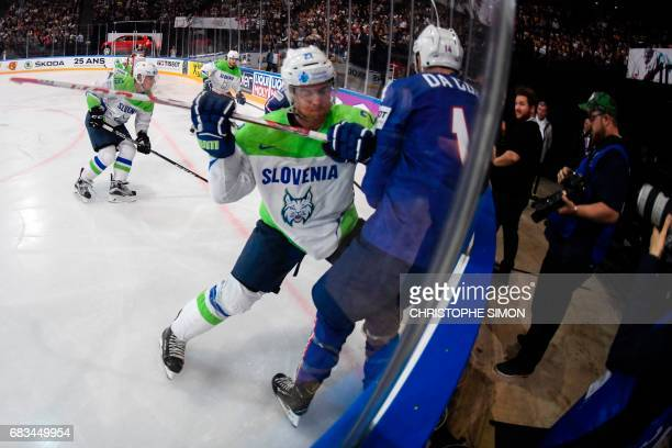 Slovenia's defender Luka Vidmar fights with France's forward Stephane da Costa during the IIHF Men's World Championship group B ice hockey match...