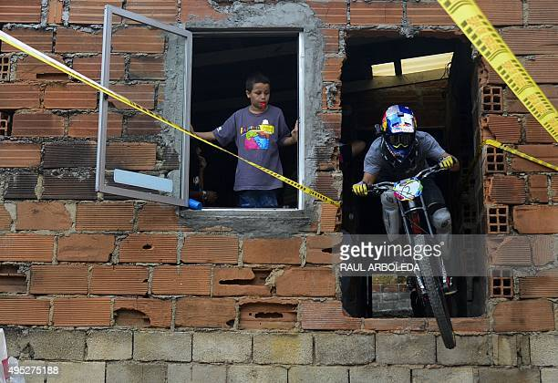 Slovenia's downhill rider Filip Polc competes during the Adrenalina Urban Bike race final at the Comuna 13 shantytown in Medellin Antioquia...