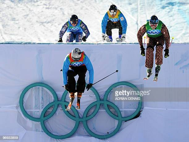 Slovenia's Filip Flisar leads the race over Canada's Stanley Hayer Japan's Hiroomi Takizawa and Casey Puckett during the 1/8 finals race during the...