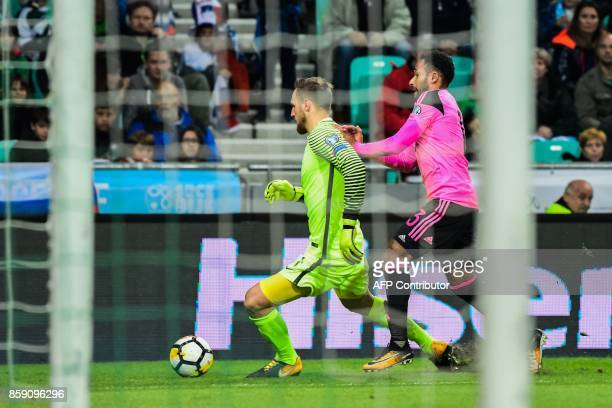 Slovenia's goalkeeper Jan Oblak attempts to outrun Scotland's Ikechi Anya during the FIFA World Cup 2018 qualification football match between...