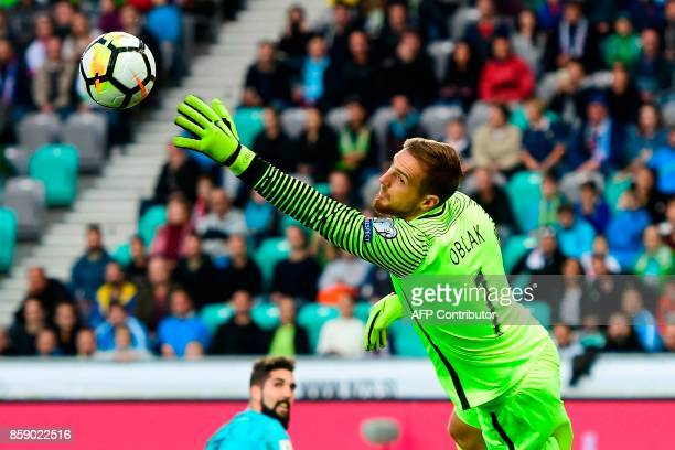 Slovenia's goalkeeper Jan Oblak goes for the save during the FIFA World Cup 2018 qualifier football match between Slovenia and Scotland at the...