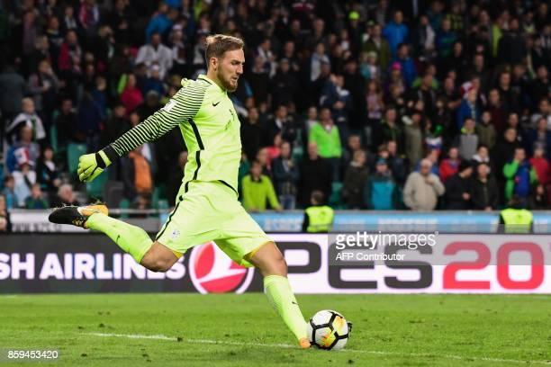 Slovenia's goalkeeper Jan Oblak kicks the ball during the FIFA World Cup 2018 qualification football match between Slovenia and Scotland at Stadium...
