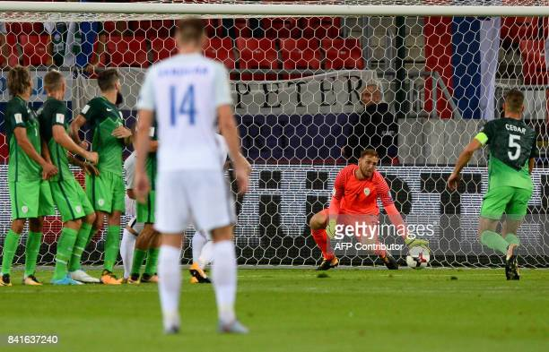 Slovenia's goalkeeper Jan Oblak makes a save during the FIFA World Cup 2018 qualification football match between Slovakia and Slovenia in Trnava...