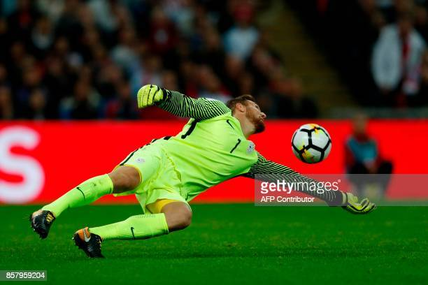 Slovenia's goalkeeper Jan Oblak makes a save from a shot from England's midfielder Jordan Henderson during the FIFA World Cup 2018 qualification...