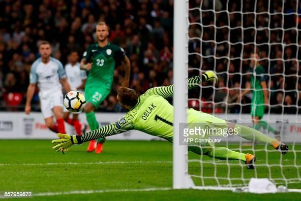 Slovenia's goalkeeper Jan Oblak saves a shot from England's midfielder Jordan Henderson during the FIFA World Cup 2018 qualification football match...