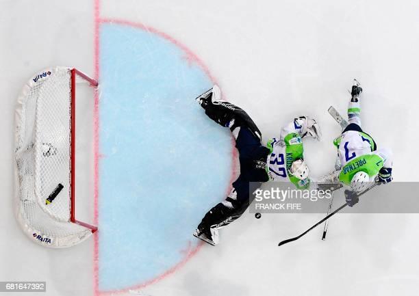 TOPSHOT CORRECTION Slovenia's goaltender Gasper Kroselj blocks the puck during the IIHF Men's World Championship group B ice hockey match Finland...
