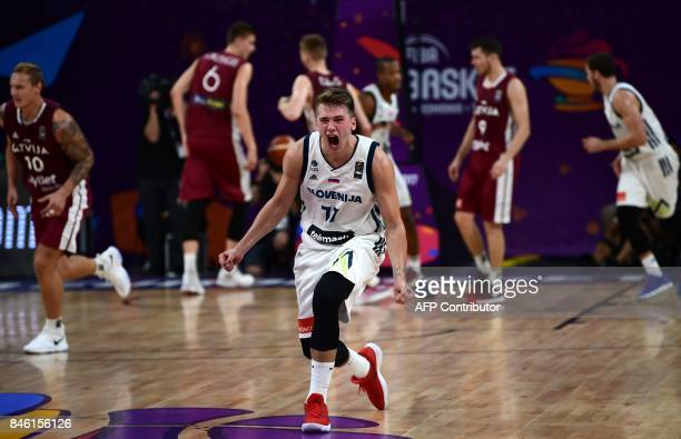Slovenias guard Luka Doncic celebrates after victory against Latvia during FIBA Eurobasket 2017 men`s quarterfinal basketball match between Slovenia...