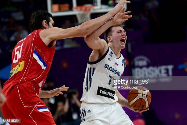 Slovenia's guard Luka Doncic vies for the ball with Serbia's center Boban Marjanovic during the FIBA Eurobasket 2017 men's Final basketball match...