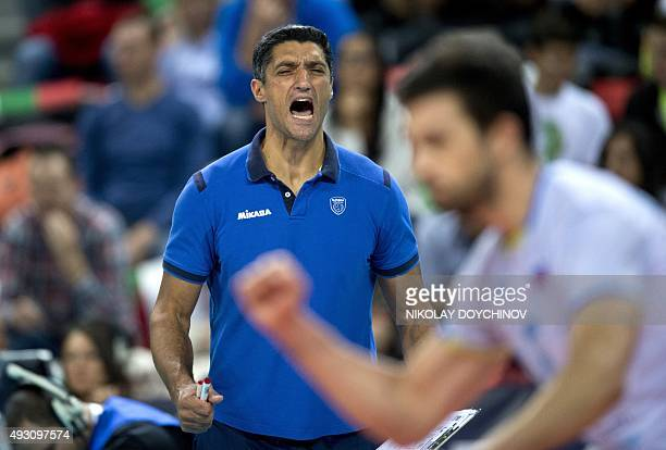 Slovenia's Head coach Andrea Giani celebrates after winning the European Volleyball Championships semifinal match against Italy in Sofia on October...