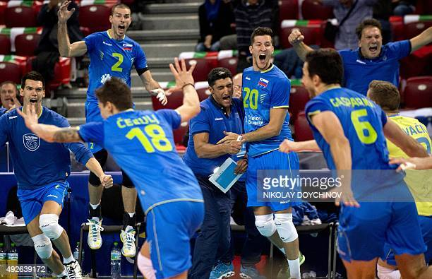 Slovenia's Head Coach Andrea Giani celebrates with Uros Pavlovic after Slovenia won the 2015 Men's European Volleyball Championship quarterfinal...
