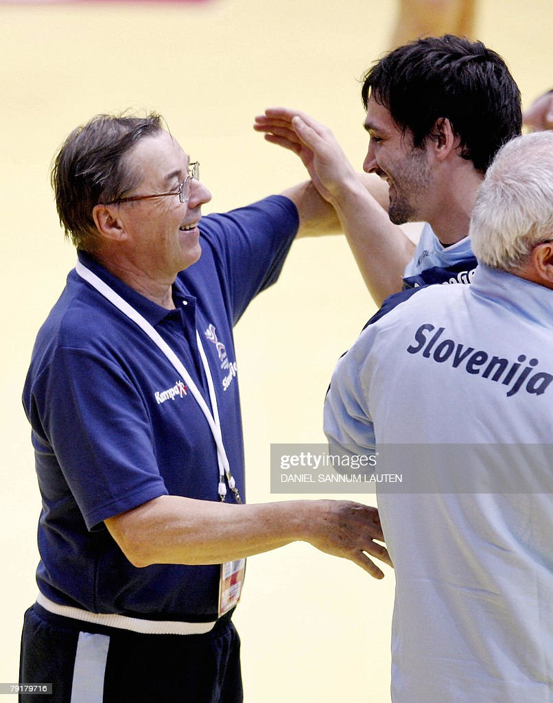 Slovenia's headcoach Stanko Iztok Ostrelic (L) celebrates with one of his player their victory on Norway at the end of their 8th Men's European Handball Championship Main Round match, 23 January 2008 at the Stavanger Idrettshall. Slovenia won 33-29.