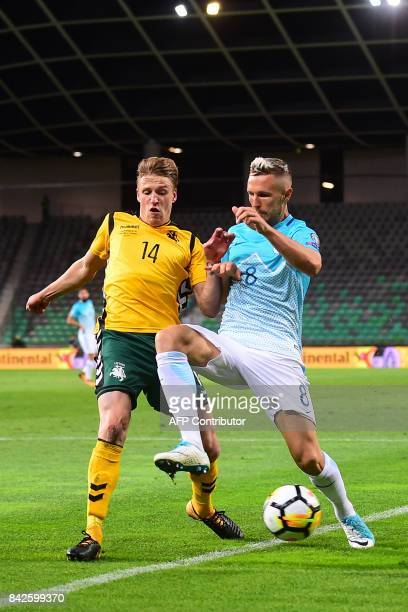 Slovenia's Jasmin Kurtic vies with Lithuania's Vykintas Slivka during the FIFA World Cup 2018 qualification football match between Slovenia and...